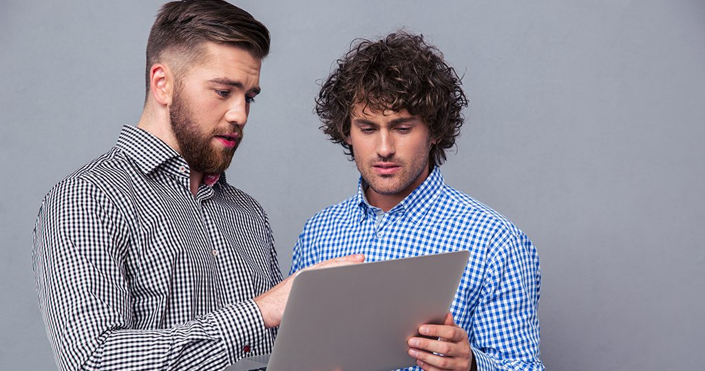 Agile Project Consultants Looking At Laptop